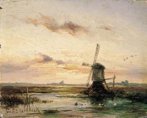 Johannes Hermann Barend Koekkoek - A windmill in a polder landscape at sunset